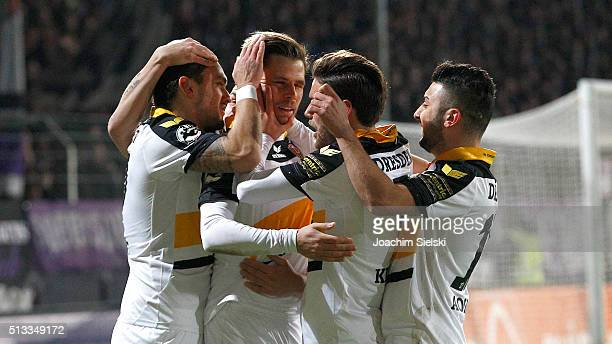 Pascal Testroet of Dresden celebrates scoring his team's first goal with teammates Justin Eilers Fabian Holthausand Niklas Kreuzer during the third...
