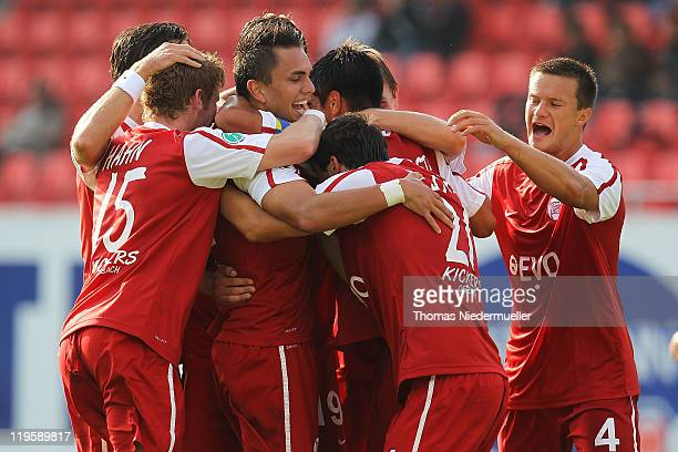 Pascal Testroet of Offenbach celebrates his goal with his teammates during the Third League match between 1.FC Heidenheim and Kickers Offenbach at...