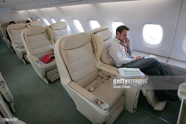 Pascal Virion of Airbus gets some work done in the business class seating area of the new Airbus A380 as it sits on the tarmac at O'Hare...