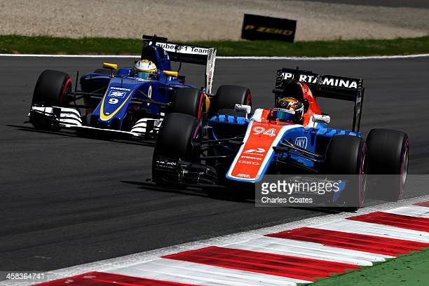 Pascal Wehrlein of Germany driving the Manor Racing MRTMercedes MRT05 Mercedes PU106C Hybrid turbo on track ahead of Marcus Ericsson of Sweden...