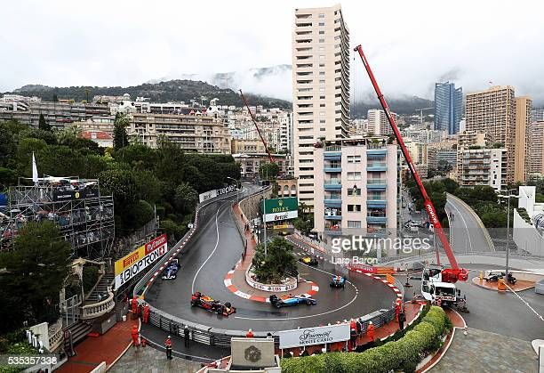 Pascal Wehrlein of Germany driving the Manor Racing MRTMercedes MRT05 Mercedes PU106C Hybrid turbo leads Max Verstappen of the Netherlands driving...