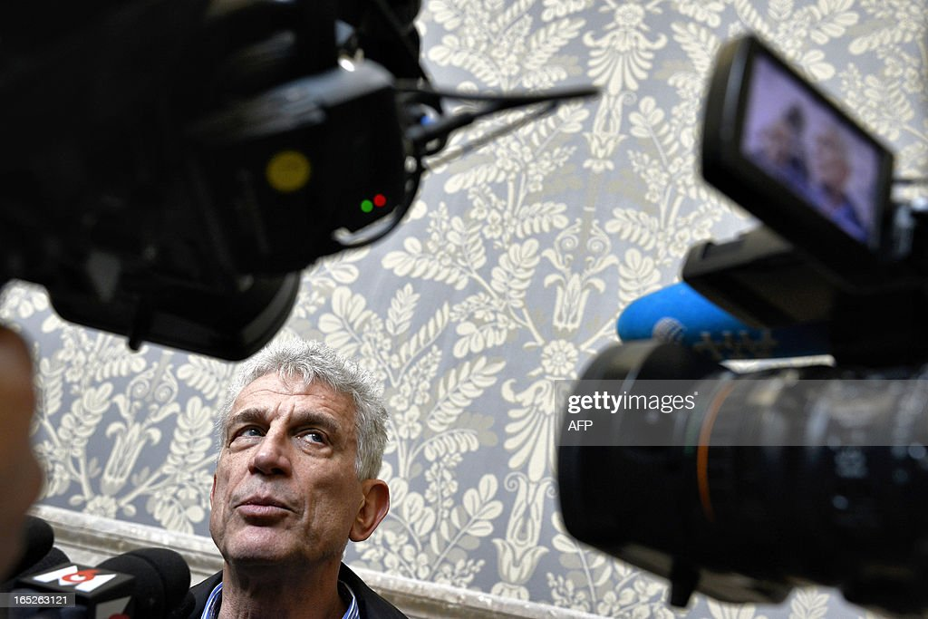 Pascal Winter, counsel for the plaintiff, answers journalists' questions in Lyon's criminal court, on April 2, 2013, on the opening day of Christophe Khider and Omar Top El Hadj's trial. They are judged for having escaped from jail using explosives and taking hostages two prison staffs.