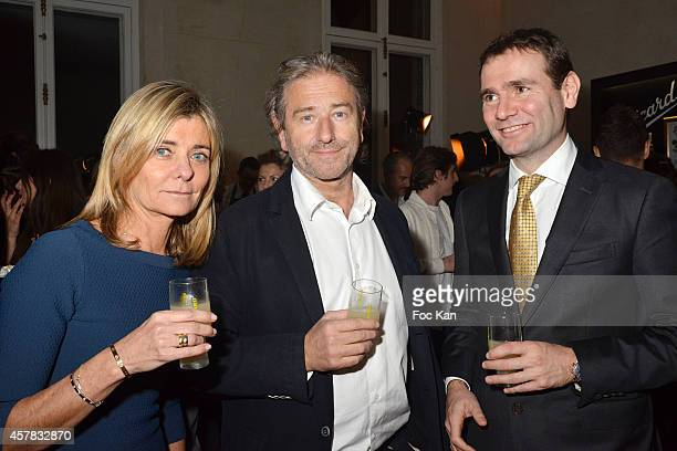 Pascale Ricard Jean Luc PouJauran and Alexandre Ricard attend the 'Bal Jaune' Dinner Party hosted by Fondation Ricard at the Hotel Salomon de...