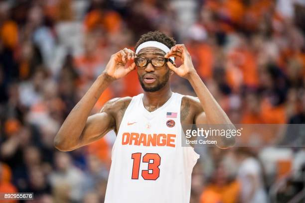 Paschal Chukwu of the Syracuse Orange adjusts his glasses during the second half against the Colgate Raiders at the Carrier Dome on December 9 2017...