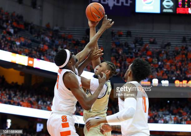 Paschal Chukwu of the Syracuse Orange alters the shot of James Banks III of the Georgia Tech Yellow Jackets during the first half at the Carrier Dome...
