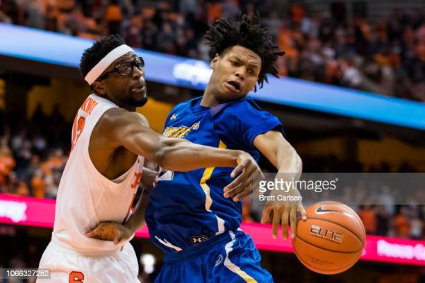 Paschal Chukwu of the Syracuse Orange battles for a rebound against Malek Green of the Morehead State Eagles during the second half at the Carrier...