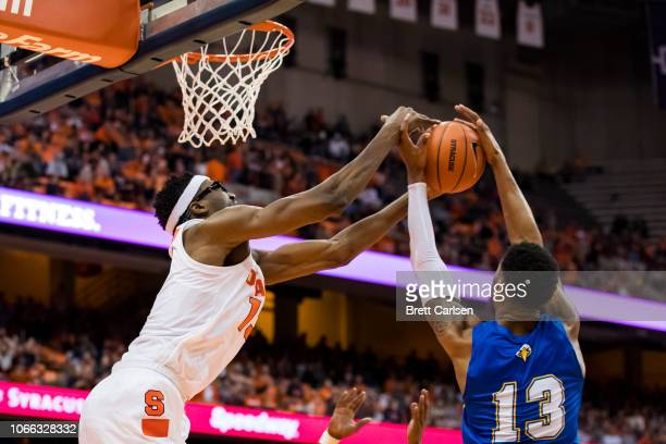 Paschal Chukwu of the Syracuse Orange battles for a rebound with Lamontray Harris of the Morehead State Eagles during the game at the Carrier Dome on...