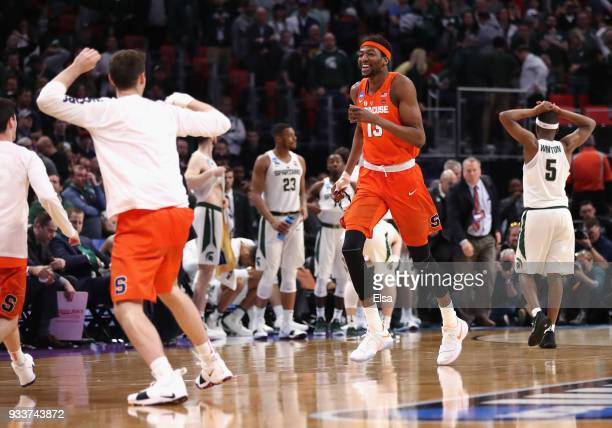 Paschal Chukwu of the Syracuse Orange celebrates defeating the Michigan State Spartans 5553 in the second round of the 2018 NCAA Men's Basketball...