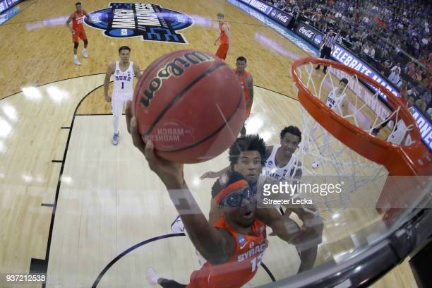 Paschal Chukwu of the Syracuse Orange dunks the ball against Marvin Bagley III of the Duke Blue Devils in the 2018 NCAA Men's Basketball Tournament...
