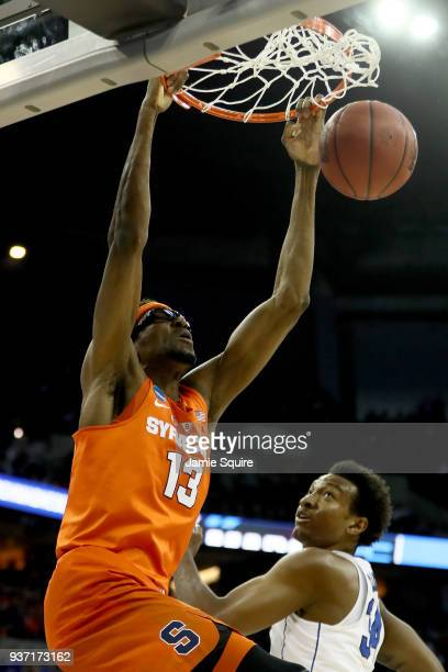 Paschal Chukwu of the Syracuse Orange dunks the ball against Wendell Carter Jr of the Duke Blue Devils during the first half in the 2018 NCAA Men's...
