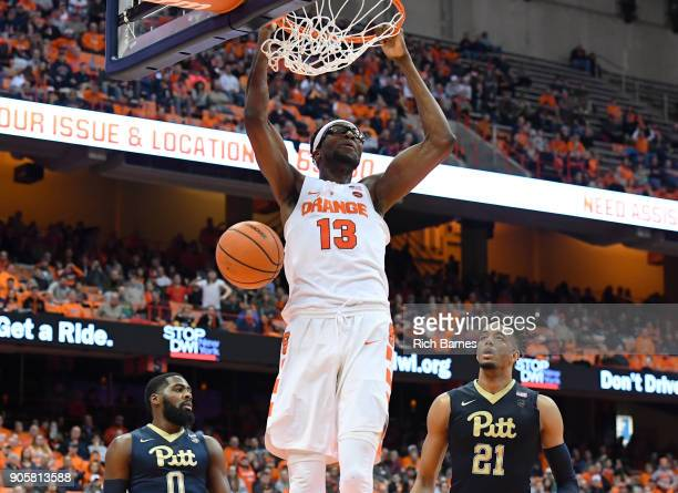 Paschal Chukwu of the Syracuse Orange dunks the ball between Jared WilsonFrame and Terrell Brown of the Pittsburgh Panthers during the first half at...