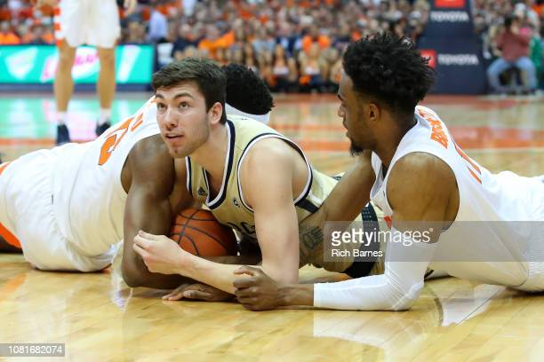 Paschal Chukwu of the Syracuse Orange, Evan Cole of the Georgia Tech Yellow Jackets and Oshae Brissett of the Syracuse Orange battle for the ball...