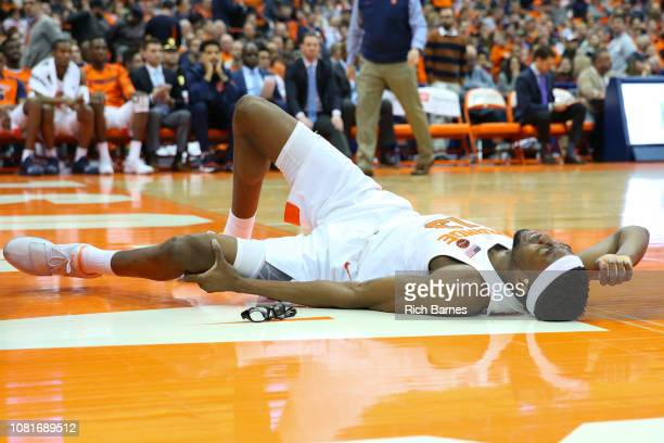 Paschal Chukwu of the Syracuse Orange holds his leg after being injured against the Georgia Tech Yellow Jackets during the second half at the Carrier...