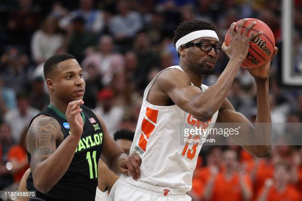 Paschal Chukwu of the Syracuse Orange looks to pass against Mark Vital of the Baylor Bears during the first half in the first round of the 2019 NCAA...