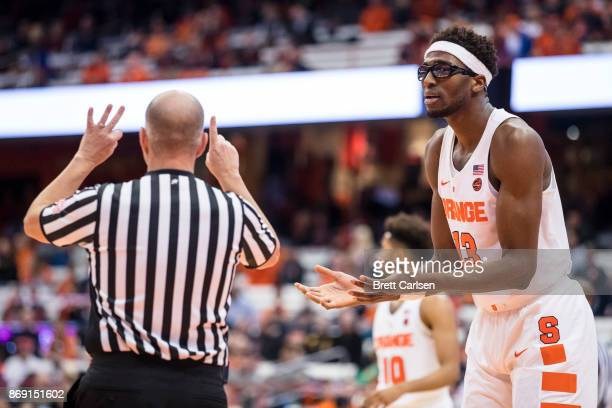 Paschal Chukwu of the Syracuse Orange protests a call against him during the first half against the Southern New Hampshire University Penmen at the...