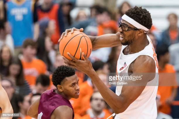Paschal Chukwu of the Syracuse Orange rebound the ball during the first half against the Colgate Raiders at the Carrier Dome on December 9 2017 in...