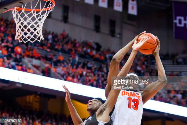 Paschal Chukwu of the Syracuse Orange rebounds the ball during the second half against the St Bonaventure Bonnies at the Carrier Dome on December 29...