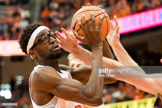 Paschal Chukwu of the Syracuse Orange rebounds the ball during the first half against the Colgate Raiders at the Carrier Dome on December 9 2017 in...