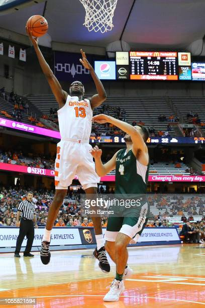 Paschal Chukwu of the Syracuse Orange shoots the ball against the defense of Tom Brown of the Le Moyne Dolphins during the second half at the Carrier...