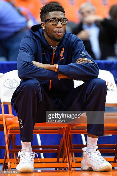 Paschal Chukwu of the Syracuse Orange sits on the bench in street clothes prior to the game against the Miami Hurricanes at the Carrier Dome on...