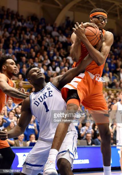 Paschal Chukwu of the Syracuse Orange takes a rebound away from Zion Williamson of the Duke Blue Devils during a game at Cameron Indoor Stadium on...