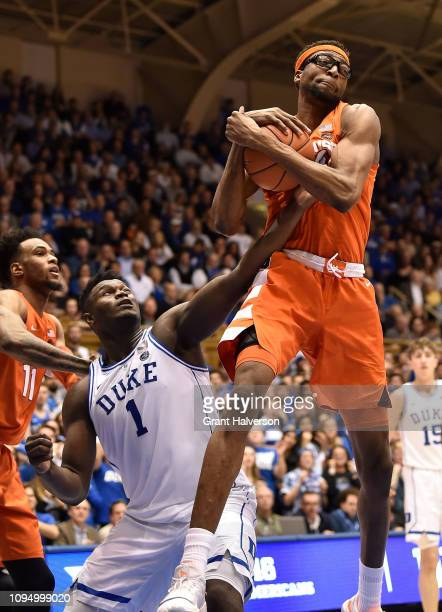 Paschal Chukwu of the Syracuse Orange takes a rebound away from Zion Williamson of the Duke Blue Devils during their game at Cameron Indoor Stadium...