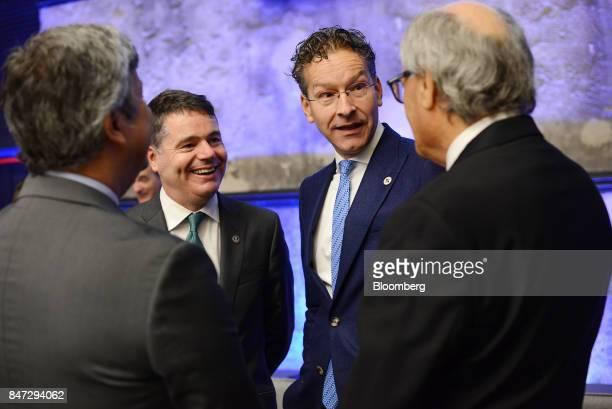 Paschal Donohoe Ireland's finance minister second left and Jeroen Dijsselbloem Dutch finance minister and head of the group of euroarea finance...