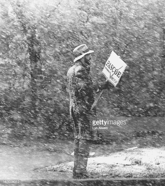 MAY 18 1983 Pasco for Mayor campaign worker stands at the cornor of Alameda and Lincoln to face the commuters with his sign and puts his back to the...