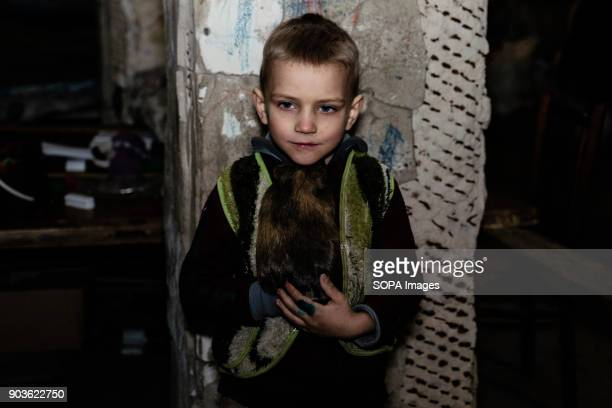Pasha 5 years old with his guinea pig Masha The conflict between the Russian backed rebels and the Ukrainian arm forces in the Donbass region of...