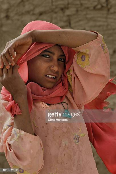 Pashtun girl stands outside her family home June 3 2010 in Walakhan a village south of Kandahar Afghanistan Tiny Walakhan which has perhaps 300...