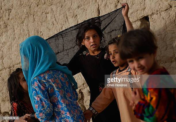 Pashtun girls gather together June 3 2010 in Walakhan a village south of Kandahar Afghanistan Tiny Walakhan which has perhaps 300 ethnic Pashtuns is...