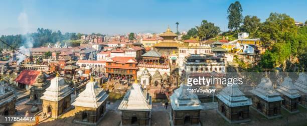 pashupatinath temple and ghats along bagmati river panorama kathmandu nepal - pashupatinath stock pictures, royalty-free photos & images