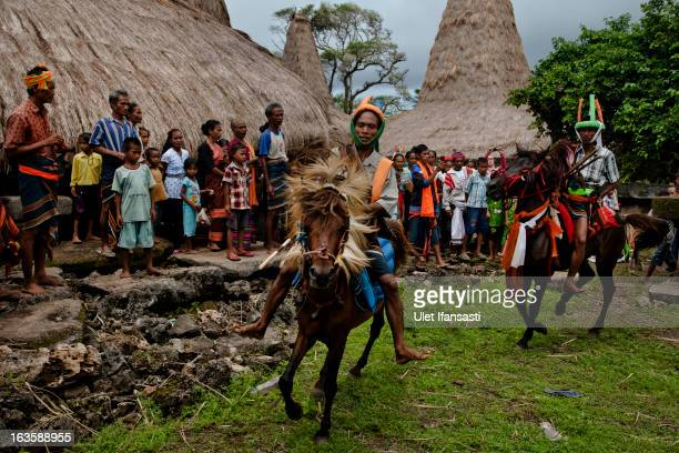 Pasola riders perform for ritual in their village before heading to the main pasola field during the pasola war festival at Wainyapu village on March...