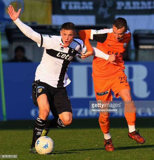 Pasquale Mazzocchi of Parma Calcio competes for the ball whit Enrico Baldini of Ascoli Picchio during the Serie B match between Parma Calcio and...