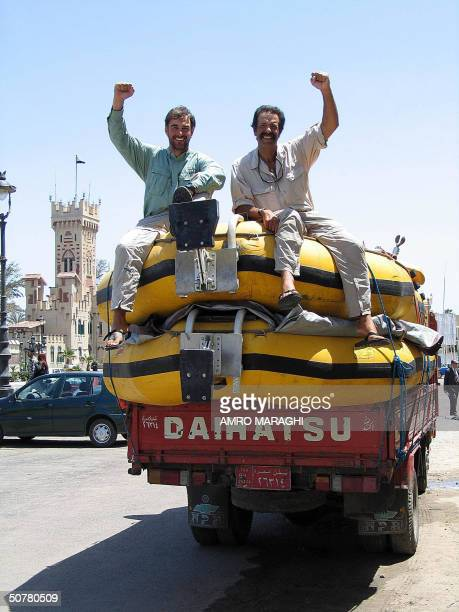 Pasquale Scaturro and Gordon Brown gestures as they sit atop of their boats in the ancient port city of Alexandria in northern Egypt 28 April 2004...