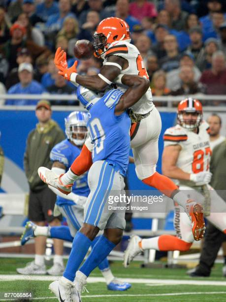 A pass hits the face of tight end David Njoku of the Cleveland Browns as he is defended by linebacker Jarrad Davis of the Detroit Lions in the first...