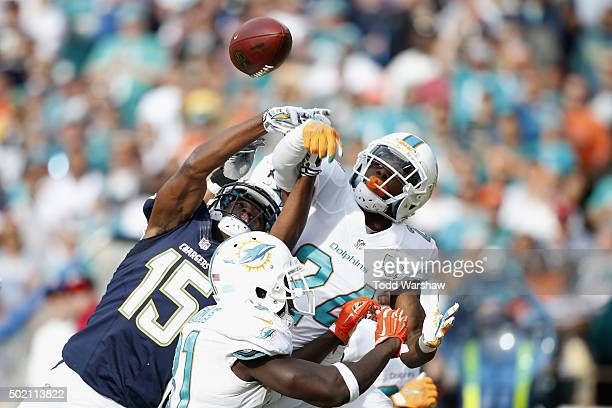 A pass intended for Dontrelle Inman of the San Diego Chargers is intercepted by Reshad Jones of the Miami Dolphins at Qualcomm Stadium on December 20...