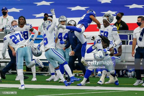Pass intended for New York Giants Wide Receiver C.J. Board is overthrown as Dallas Cowboys Defensive End DeMarcus Lawrence attempts to shield himself...