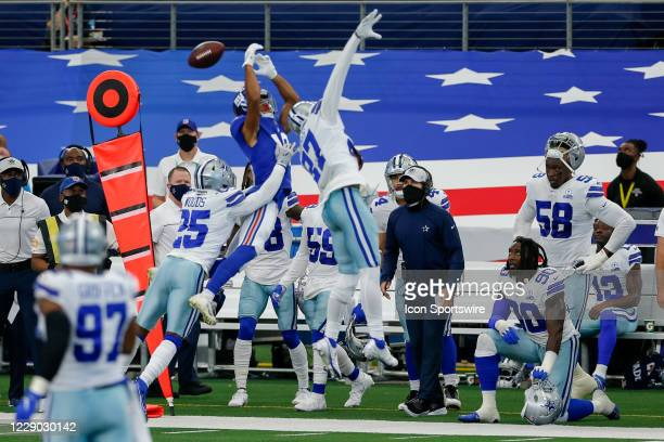 Pass intended for New York Giants Wide Receiver C.J. Board is broken up by Dallas Cowboys Cornerback Trevon Diggs and Safety Xavier Woods during the...
