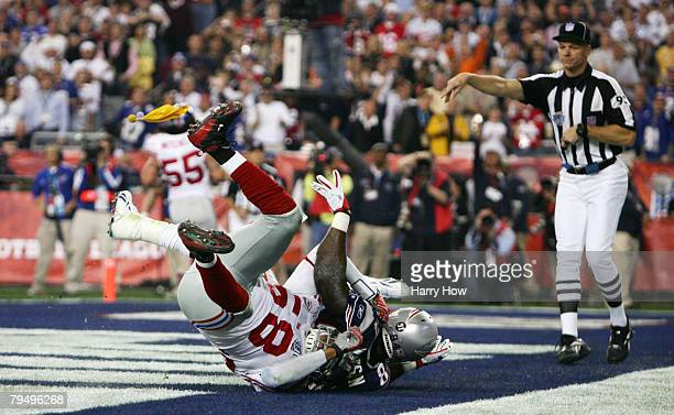 Pass interference is called on linebacker Antonio Pierce of the New York Giants while defending tight end Benjamin Watson of the New England Patriots...