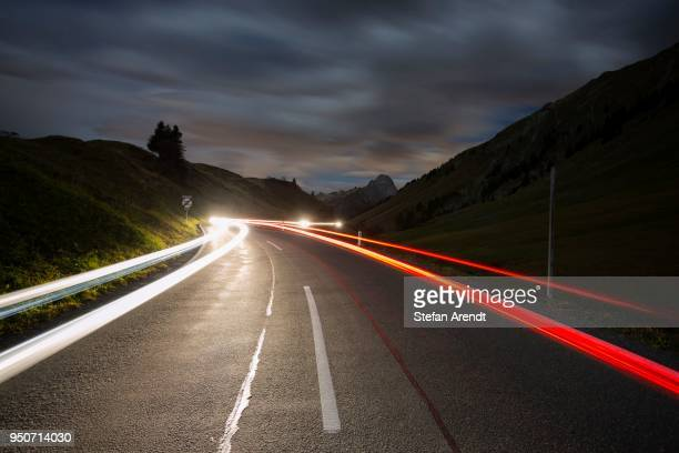Pass road at night with light streaks from cars on Hochtannbergpass, Vorarlberg, Bregenz Forest, Austria