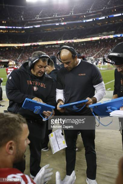 Pass Rush Specialist Chris Kiffin and Defensive Coordinator Robert Saleh of the San Francisco 49ers talk on the sideline during the game against the...