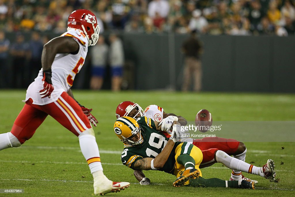 Pass to Myles White #19 of the Green Bay Packers is broken up by DeMarcus Van Dyke #40 of the Kansas City Chiefs on August 28, 2014 at Lambeau Field in Green Bay, Wisconsin.