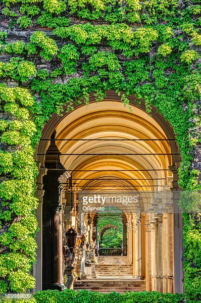 passageway of stairs and arches. - klooster stockfoto's en -beelden