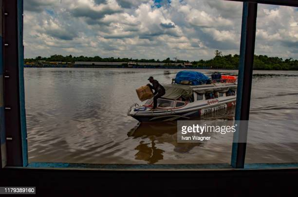 passanger speedboat - west kalimantan stock pictures, royalty-free photos & images