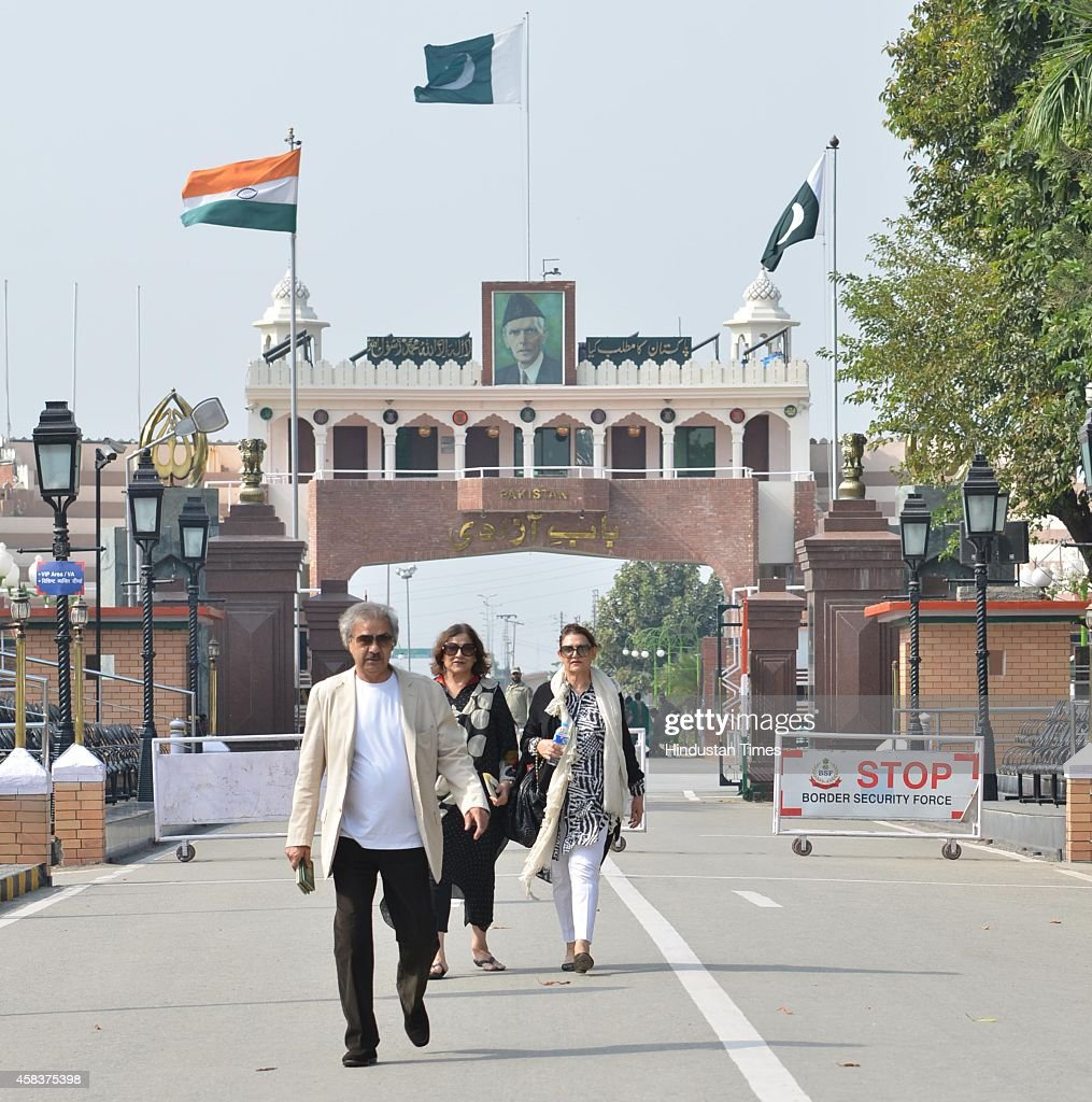 Passangers arrive from Pakistan on foot at Attari Wagah international border a day after suicide attack on Pakistani side on November 3 2014 near...