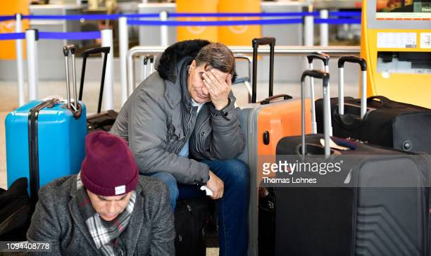 Passangers from Egypt wait between their luggage at Frankfurt Airport during a strike by security personnel on January 15, 2019 in Frankfurt,...