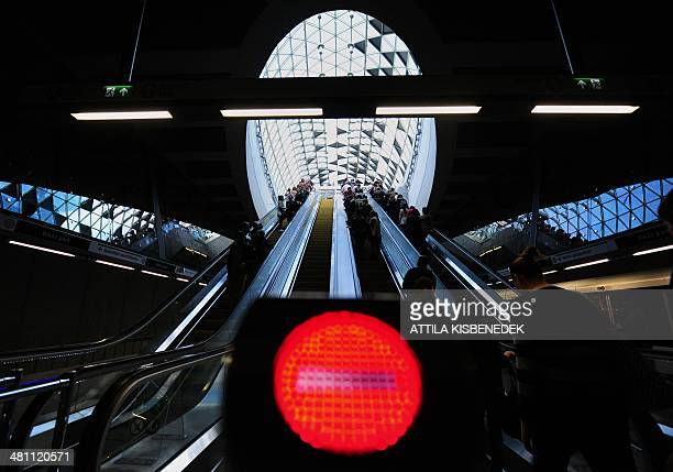 Passangers ride on an escalator at the new metro line No 4 at Bikas park in Budapest on March 28 2014Two years late Budapest's UNESCO World Heritage...