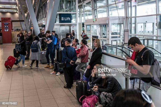 Passangers wait to drop their bags after arriving early to check in at Sydney Airport due to increased security measures on July 31 2017 in Sydney...