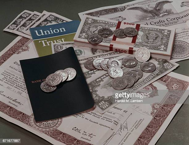 """passbook, banknote and coin "" - {{relatedsearchurl(carousel.phrase)}} stock pictures, royalty-free photos & images"